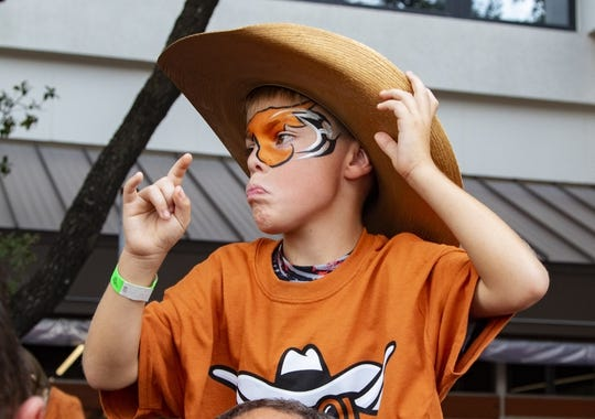 Oct 13, 2018; Austin, TX, USA; Young Texas Longhorns fan cheers the team at the Bevo Parade before the game against the Baylor Bears at Darrell K Royal-Texas Memorial Stadium. Mandatory Credit: John Gutierrez-USA TODAY Sports