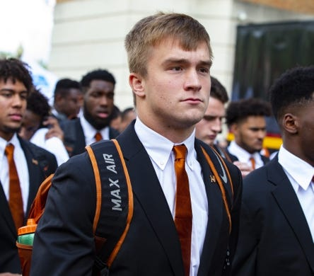 Oct 13, 2018; Austin, TX, USA; Texas Longhorns quarterback Sam Ehlinger (11) walks down the Bevo Parade before the game against the Baylor Bears at Darrell K Royal-Texas Memorial Stadium. Mandatory Credit: John Gutierrez-USA TODAY Sports