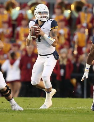 Oct 13, 2018; Ames, IA, USA; West Virginia Mountaineers quarterback Will Grier (7) drops back to pass against the Iowa State Cyclones at Jack Trice Stadium. Mandatory Credit: Reese Strickland-USA TODAY Sports