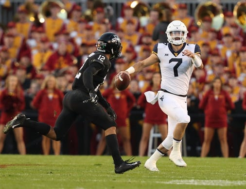 Oct 13, 2018; Ames, IA, USA; West Virginia Mountaineers quarterback Will Grier (7) looks to pass against the Iowa State Cyclones at Jack Trice Stadium. Mandatory Credit: Reese Strickland-USA TODAY Sports