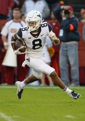 Oct 13, 2018; Ames, IA, USA; West Virginia Mountaineers wide receiver Marcus Simms (8) runs the football against the Iowa State Cyclones at Jack Trice Stadium. Mandatory Credit: Reese Strickland-USA TODAY Sports