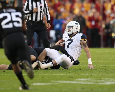 Oct 13, 2018; Ames, IA, USA; Iowa State Cyclones defensive end Spencer Benton (58) sacks West Virginia Mountaineers quarterback Will Grier (7) at Jack Trice Stadium. Mandatory Credit: Reese Strickland-USA TODAY Sports