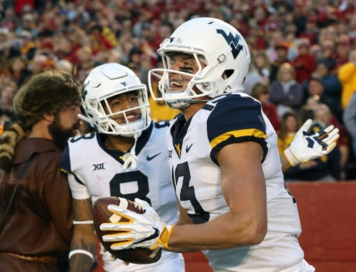 Oct 13, 2018; Ames, IA, USA; West Virginia Mountaineers wide receiver David Sills V (13) celebrates with wide receiver Marcus Simms (8) after scoring a touchdown against the Iowa State Cyclones at Jack Trice Stadium. Mandatory Credit: Reese Strickland-USA TODAY Sports