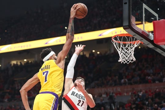Oct 18, 2018; Portland, OR, USA;  Los Angeles Lakers center JaVale McGee (7) dunks over Portland Trail Blazers center Jusuf Nurkic (27) at Moda Center. Mandatory Credit: Jaime Valdez-USA TODAY Sports