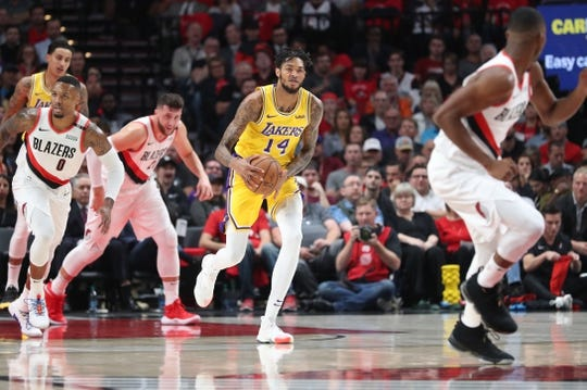 Oct 18, 2018; Portland, OR, USA;  Los Angeles Lakers forward Brandon Ingram (14) looks to pass the ball against the Portland Trail Blazers in the first half at Moda Center. Mandatory Credit: Jaime Valdez-USA TODAY Sports