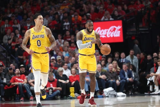 Oct 18, 2018; Portland, OR, USA;  Los Angeles Lakers forward LeBron James (23) gives directions to teammates in the first half against the Portland Trail Blazers at Moda Center. Mandatory Credit: Jaime Valdez-USA TODAY Sports