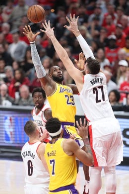 Oct 18, 2018; Portland, OR, USA; Los Angeles Lakers forward LeBron James (23) shoots over Portland Trail Blazers center Jusuf Nurkic (27) in the first half at Moda Center. Mandatory Credit: Jaime Valdez-USA TODAY Sports