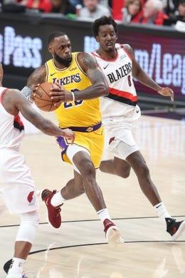Oct 18, 2018; Portland, OR, USA;  Los Angeles Lakers forward LeBron James (23) drives past Portland Trail Blazers forward Al-Farouq Aminu (8) in the first half at Moda Center. Mandatory Credit: Jaime Valdez-USA TODAY Sports
