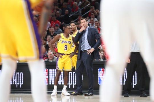 Oct 18, 2018; Portland, OR, USA;  Los Angeles Lakers guard Rajon Rondo (9) talks with Los Angeles Lakers head coach Luke Walton in the first half at Moda Center. Mandatory Credit: Jaime Valdez-USA TODAY Sports