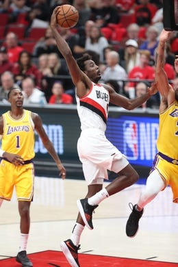 Oct 18, 2018; Portland, OR, USA; Portland Trail Blazers forward Al-Farouq Aminu (8) dunks the ball against the Los Angeles Lakers in the second half at Moda Center. Mandatory Credit: Jaime Valdez-USA TODAY Sports