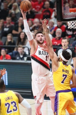 Oct 18, 2018; Portland, OR, USA;  Portland Trail Blazers center Jusuf Nurkic (27) shoots the ball over Los Angeles Lakers center JaVale McGee (7) in the second half at Moda Center. Mandatory Credit: Jaime Valdez-USA TODAY Sports