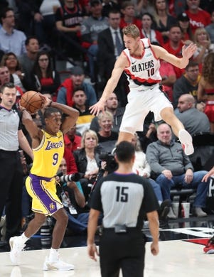 Oct 18, 2018; Portland, OR, USA;  Portland Trail Blazers forward Jake Layman (10) defends Los Angeles Lakers guard Rajon Rondo (9) in the second half at Moda Center. Mandatory Credit: Jaime Valdez-USA TODAY Sports