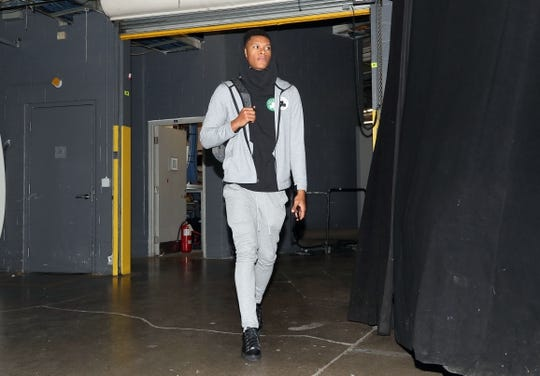 Oct 19, 2018; Toronto, Ontario, CAN; Boston Celtics forward P.J. Dozier (50) arrives at the arena before their game against the Toronto Raptors at Scotiabank Arena. Mandatory Credit: Tom Szczerbowski-USA TODAY Sports