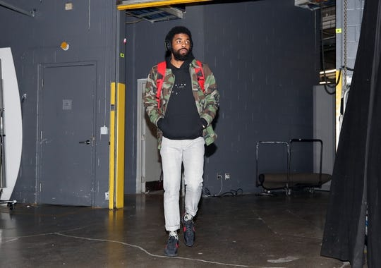 Oct 19, 2018; Toronto, Ontario, CAN; Boston Celtics guard Kyrie Irving (11) arrives at the arena before their game against the Toronto Raptors at Scotiabank Arena. Mandatory Credit: Tom Szczerbowski-USA TODAY Sports
