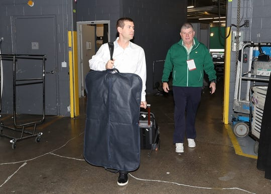 Oct 19, 2018; Toronto, Ontario, CAN; Boston Celtics head coach Brad Stevens (left) arrives at the arena before a game against the Toronto Raptors at Scotiabank Arena. Mandatory Credit: Tom Szczerbowski-USA TODAY Sports