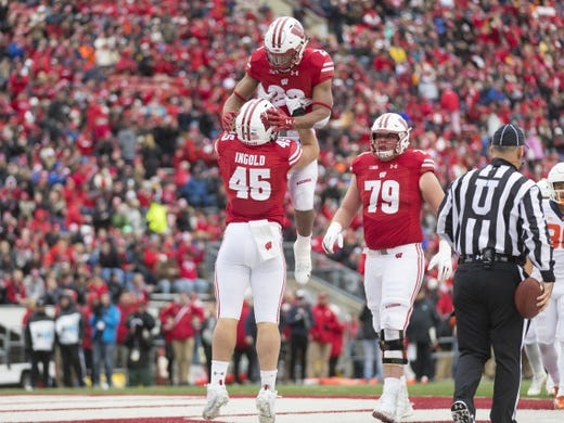 Oct 20, 2018; Madison, WI, USA; Wisconsin Badgers fullback Alec Ingold (45) celebrates with running back Jonathan Taylor (23) after scoring a touchdown during the first quarter against the Illinois Fighting Illini at Camp Randall Stadium. Mandatory Credit: Jeff Hanisch-USA TODAY Sports
