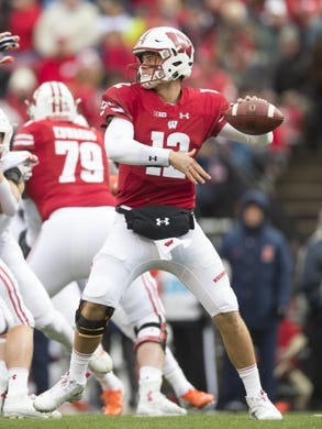 Oct 20, 2018; Madison, WI, USA; Wisconsin Badgers quarterback Alex Hornibrook (12) throws a pass during the first quarter against  the Illinois Fighting Illini at Camp Randall Stadium. Mandatory Credit: Jeff Hanisch-USA TODAY Sports