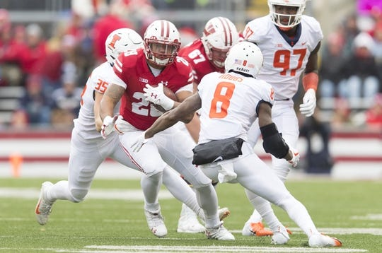 Oct 20, 2018; Madison, WI, USA; Wisconsin Badgers running back Jonathan Taylor (23) rushes with the football during the first quarter against the Illinois Fighting Illini at Camp Randall Stadium. Mandatory Credit: Jeff Hanisch-USA TODAY Sports