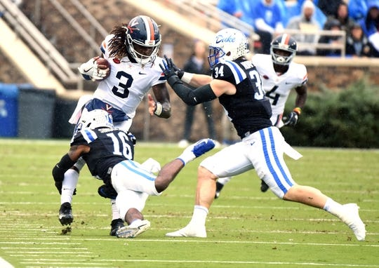 Oct 20, 2018; Durham, NC, USA; Virginia Cavaliers quarterback Bryce Perkins (3) is tackled by Duke Blue Devils safety Dylan Singleton (16) during the first half at Wallace Wade Stadium. Mandatory Credit: Rob Kinnan-USA TODAY Sports