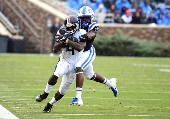 Oct 20, 2018; Durham, NC, USA; Virginia Cavaliers running back Olamide Zaccheus (4) is tackled after a catch by Duke Blue Devils safety Marquis Waters (10) during the first half at Wallace Wade Stadium. Mandatory Credit: Rob Kinnan-USA TODAY Sports