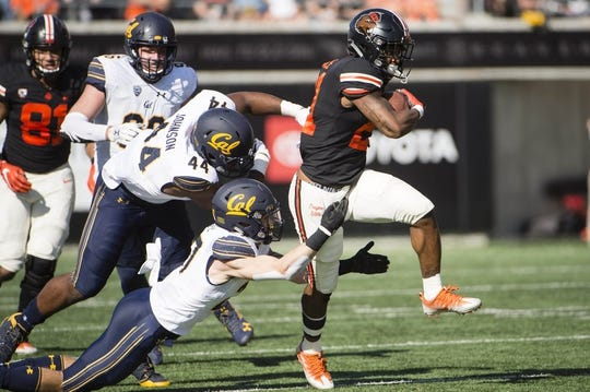 Oct 20, 2018; Corvallis, OR, USA; Oregon State Beavers running back Artavis Pierce (21) breaks away from California Golden Bears safety Ashtyn Davis (27) during the first half at Reser Stadium. Mandatory Credit: Troy Wayrynen-USA TODAY Sports