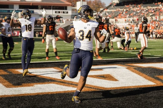Oct 20, 2018; Corvallis, OR, USA; California Golden Bears running back Christopher Brown Jr. (34) celebrates after scoring a touchdown during the second half against the Oregon State Beavers at Reser Stadium. The California Golden Bears beat the Oregon State Beavers 49-7. Mandatory Credit: Troy Wayrynen-USA TODAY Sports