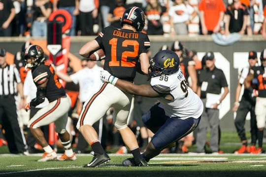 Oct 20, 2018; Corvallis, OR, USA; California Golden Bears nose guard Chris Palmer (98) sacks Oregon State Beavers quarterback Jack Colletto (12) during the second half at Reser Stadium. The California Golden Bears beat the Oregon State Beavers 49-7. Mandatory Credit: Troy Wayrynen-USA TODAY Sports
