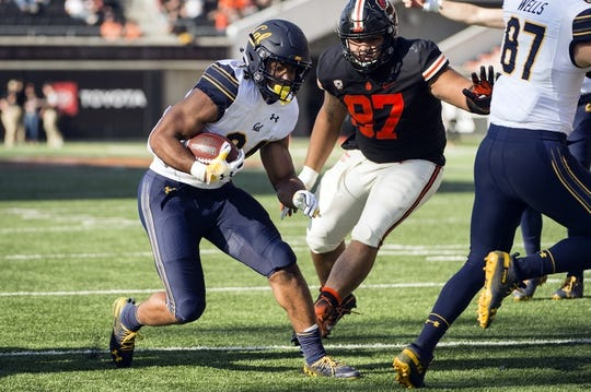 Oct 20, 2018; Corvallis, OR, USA; California Golden Bears running back Christopher Brown Jr. (34) runs past Oregon State Beavers defenders during the second half to score a touchdown at Reser Stadium. The California Golden Bears beat the Oregon State Beavers 49-7. Mandatory Credit: Troy Wayrynen-USA TODAY Sports
