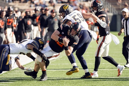 Oct 20, 2018; Corvallis, OR, USA; Oregon State Beavers quarterback Jack Colletto (12) picks up a first down during the second half against the California Golden Bears at Reser Stadium. The California Golden Bears beat the Oregon State Beavers 49-7. Mandatory Credit: Troy Wayrynen-USA TODAY Sports
