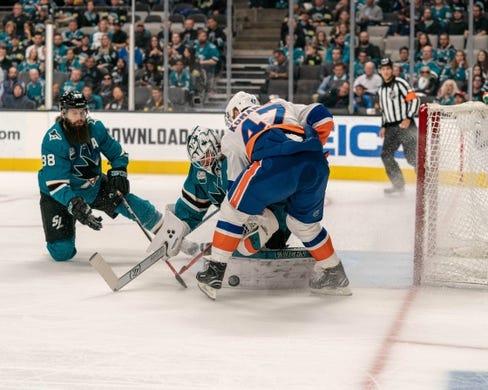 Oct 20, 2018; San Jose, CA, USA; San Jose Sharks goaltender Martin Jones (31) makes a save against New York Islanders center Leo Komarov (47) during the first period at SAP Center at San Jose. Mandatory Credit: Neville E. Guard-USA TODAY Sports
