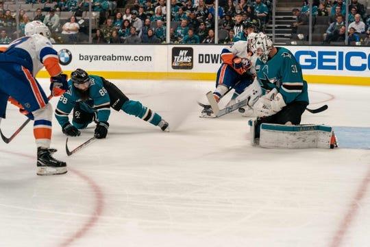 Oct 20, 2018; San Jose, CA, USA; San Jose Sharks goaltender Martin Jones (31) makes a save during the first period against the New York Islanders at SAP Center at San Jose. Mandatory Credit: Neville E. Guard-USA TODAY Sports