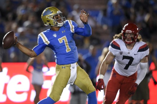 Oct 20, 2018; Pasadena, CA, USA; UCLA Bruins quarterback Dorian Thompson-Robinson (7) attempts a pass while under pressure by Arizona Wildcats linebacker Colin Schooler (7) during the first half at Rose Bowl. Mandatory Credit: Kelvin Kuo-USA TODAY Sports