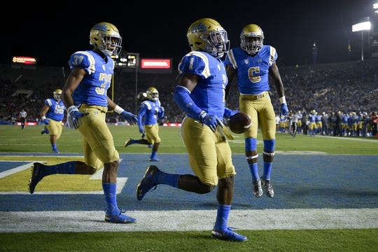 Oct 20, 2018; Pasadena, CA, USA; UCLA Bruins defensive back Darnay Holmes (1) celebrates after a fumble recovery during the first half against the Arizona Wildcats at Rose Bowl. Mandatory Credit: Kelvin Kuo-USA TODAY Sports