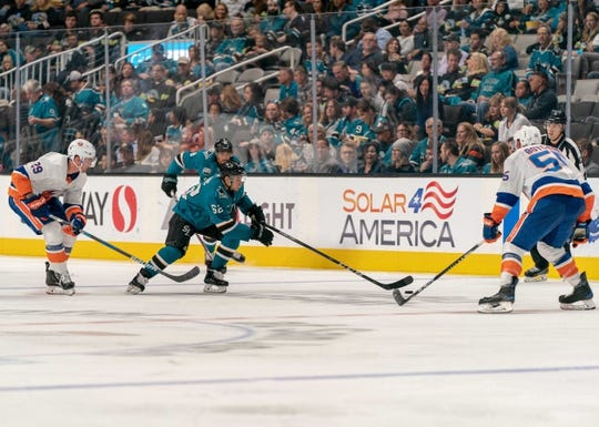 Oct 20, 2018; San Jose, CA, USA; San Jose Sharks right wing Kevin Labanc (62) skates with the puck against New York Islanders defenseman Johnny Boychuk (55) during the second period at SAP Center at San Jose. Mandatory Credit: Neville E. Guard-USA TODAY Sports