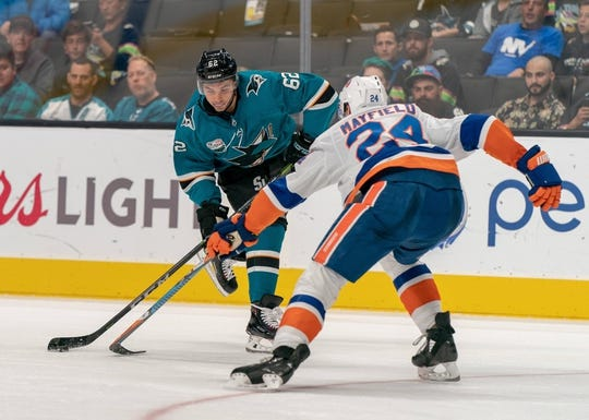 Oct 20, 2018; San Jose, CA, USA; San Jose Sharks right wing Kevin Labanc (62) shoots the puck against New York Islanders defenseman Scott Mayfield (24) during the second period at SAP Center at San Jose. Mandatory Credit: Neville E. Guard-USA TODAY Sports