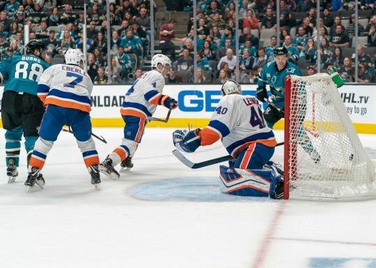 Oct 20, 2018; San Jose, CA, USA; San Jose Sharks defenseman Brent Burns (88) scores during the second period against New York Islanders goaltender Robin Lehner (40) at SAP Center at San Jose. Mandatory Credit: Neville E. Guard-USA TODAY Sports