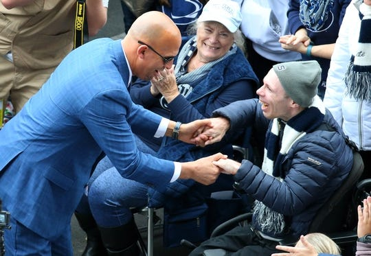 Oct 13, 2018; University Park, PA, USA; Penn State Nittany Lions head coach James Franklin greets a fan prior to the game against the Michigan State Spartans at Beaver Stadium. Mandatory Credit: Rich Barnes-USA TODAY Sports