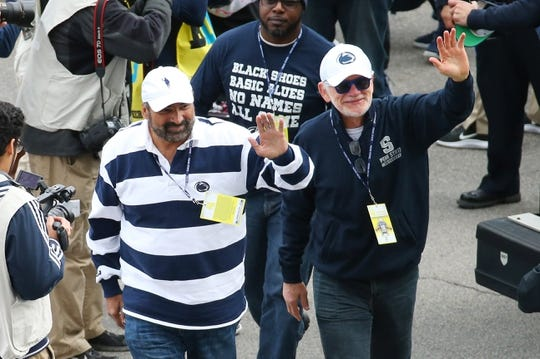 Oct 13, 2018; University Park, PA, USA; Former Penn State Nittany Lions players Franco Harris (left) and Jack Ham (right) greet fans prior to the game against the Michigan State Spartans at Beaver Stadium. Mandatory Credit: Rich Barnes-USA TODAY Sports