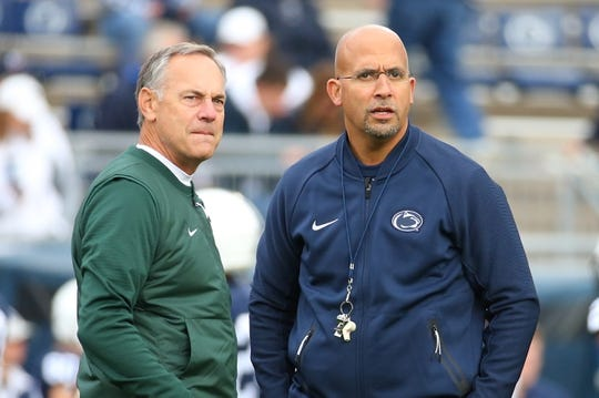 Oct 13, 2018; University Park, PA, USA; Michigan State Spartans head coach Mark Dantonio (left) and Penn State Nittany Lions head coach James Franklin (right) look on prior to the game at Beaver Stadium. Mandatory Credit: Rich Barnes-USA TODAY Sports