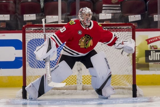 Oct 21, 2018; Chicago, IL, USA; Chicago Blackhawks goaltender Cam Ward (30) warms up prior to a game against the Tampa Bay Lightning at United Center. Mandatory Credit: Patrick Gorski-USA TODAY Sports