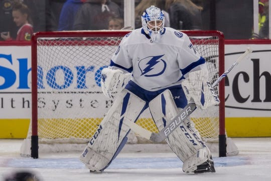 Oct 21, 2018; Chicago, IL, USA; Tampa Bay Lightning goaltender Louis Domingue (70) warms up prior to a game against the Chicago Blackhawks at United Center. Mandatory Credit: Patrick Gorski-USA TODAY Sports