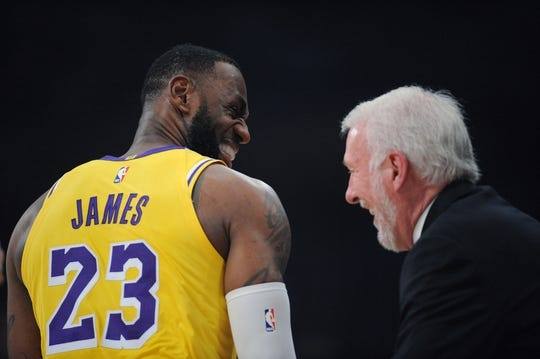 October 22, 2018; Los Angeles, CA, USA; Los Angeles Lakers forward LeBron James (23) meets with San Antonio Spurs head coach Gregg Popovich before the first half at Staples Center. Mandatory Credit: Gary A. Vasquez-USA TODAY Sports
