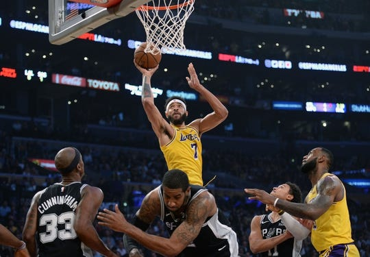 October 22, 2018; Los Angeles, CA, USA; Los Angeles Lakers center JaVale McGee (7) moves to the basket against San Antonio Spurs forward LaMarcus Aldridge (12) during the first half at Staples Center. Mandatory Credit: Gary A. Vasquez-USA TODAY Sports
