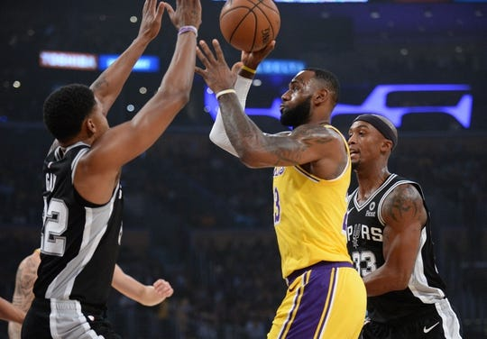 October 22, 2018; Los Angeles, CA, USA; Los Angeles Lakers forward LeBron James (23) moves to the basket against San Antonio Spurs forward Rudy Gay (22) during the first half at Staples Center. Mandatory Credit: Gary A. Vasquez-USA TODAY Sports