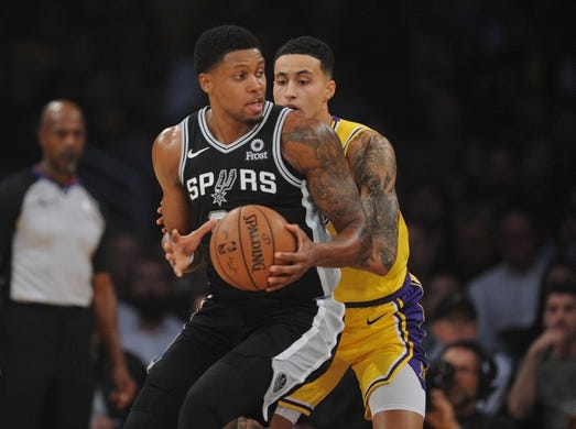 October 22, 2018; Los Angeles, CA, USA; San Antonio Spurs forward Rudy Gay (22) moves the ball against Los Angeles Lakers forward Kyle Kuzma (0) during the first half at Staples Center. Mandatory Credit: Gary A. Vasquez-USA TODAY Sports