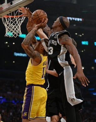 October 22, 2018; Los Angeles, CA, USA; San Antonio Spurs forward Dante Cunningham (33) defends against Los Angeles Lakers forward Michael Beasley (11) during the first half at Staples Center. Mandatory Credit: Gary A. Vasquez-USA TODAY Sports