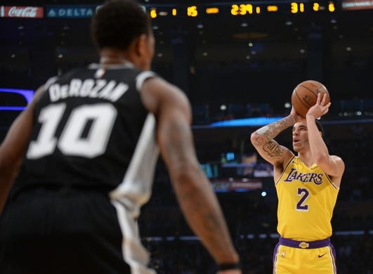 October 22, 2018; Los Angeles, CA, USA; Los Angeles Lakers guard Lonzo Ball (2) shoots against San Antonio Spurs guard DeMar DeRozan (10) during the first half at Staples Center. Mandatory Credit: Gary A. Vasquez-USA TODAY Sports