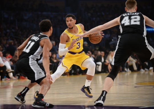 October 22, 2018; Los Angeles, CA, USA; Los Angeles Lakers guard Josh Hart (3) moves the ball against San Antonio Spurs forward Davis Bertans (42) and guard Bryn Forbes (11) during the first half at Staples Center. Mandatory Credit: Gary A. Vasquez-USA TODAY Sports