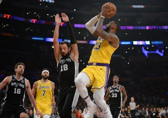 October 22, 2018; Los Angeles, CA, USA; Los Angeles Lakers forward LeBron James (23) moves to the basket against San Antonio Spurs guard Marco Belinelli (18) during the first half at Staples Center. Mandatory Credit: Gary A. Vasquez-USA TODAY Sports