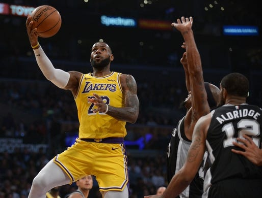October 22, 2018; Los Angeles, CA, USA; Los Angeles Lakers forward LeBron James (23) moves to the basket against the San Antonio Spurs during the first half at Staples Center. Mandatory Credit: Gary A. Vasquez-USA TODAY Sports